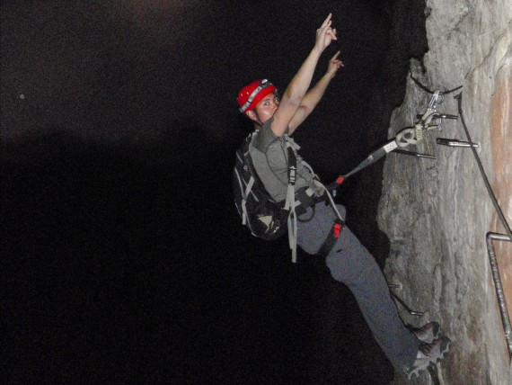 Ascending the Via Ferrata by the light of the moon.